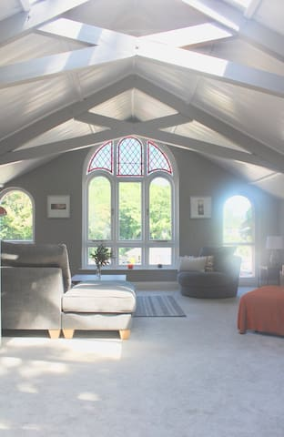 Beautifully Converted Chapel with large windows that enhance the light in the upstairs open-plan living area.