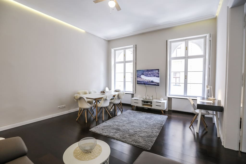 Spacious bright Living room, with large dining table, comfortable couch and big screen TV with local and international channels.