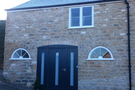 Lovingly restored, warm Coach house - Dursley - Huis