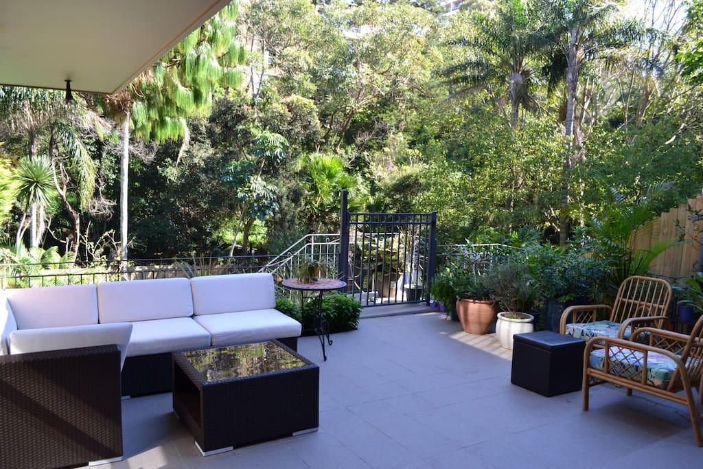 Spacious terrace overlooking pool and garden