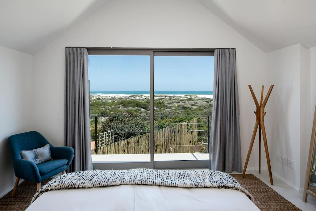 master bedroom with balcony and 180 degrees sea views