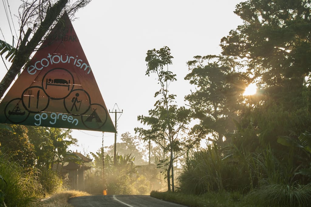 Look out for our triangle sing at the main road. We are located right north of the stretch of forest that separates lake Buyan and lake Tamblingan