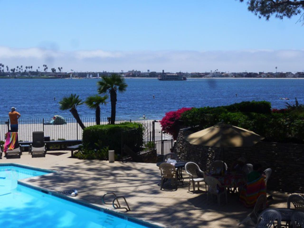 Pool area on bay includes fitness and game rooms, showers and gas BBQ grills