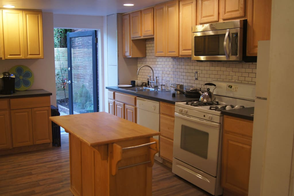 Brand New Kitchen with door to Private Garden with BBQ and Herbs!