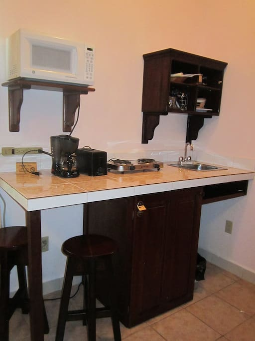 room with a mini kitchen