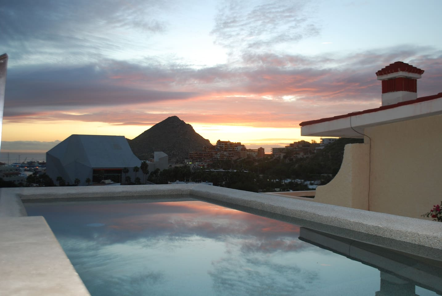 Enjoy the beautiful sunrise from your private infinity pool.