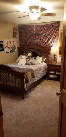Second bedroom with queen size bed and private, attached full bathroom.