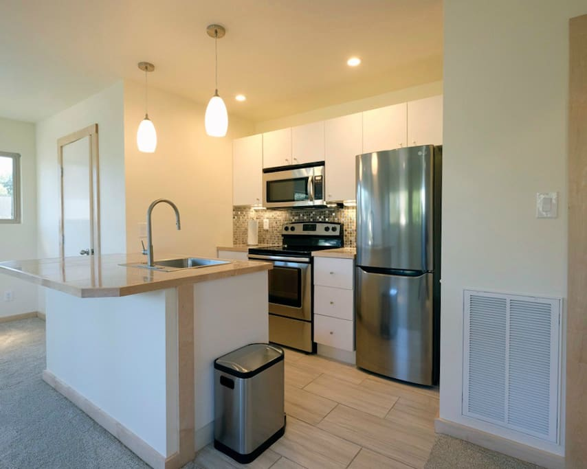 Full kitchen with range, microwave, outside vent, dishwasher, disposal, stainless steel