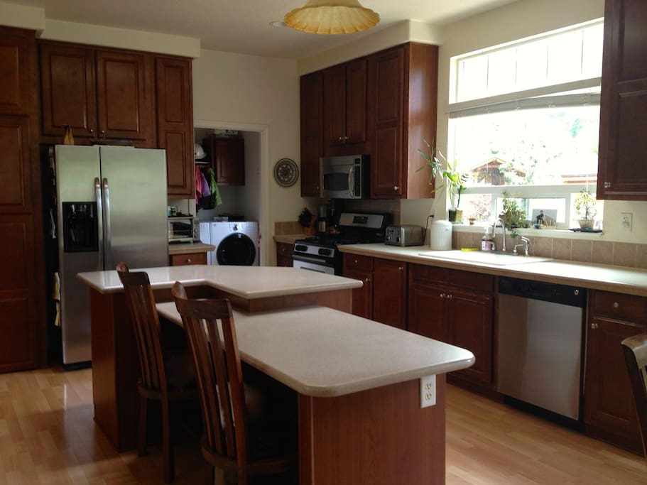 Large, fully stocked kitchen and laundry room