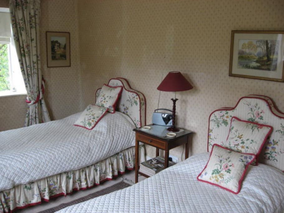 The bedroom overlooks the garden both front and side
