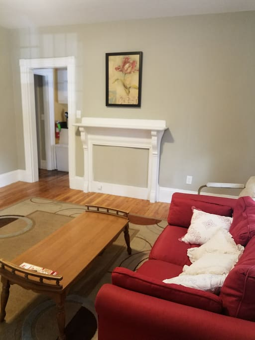 The living room is spacious and warm with lots of natural light.