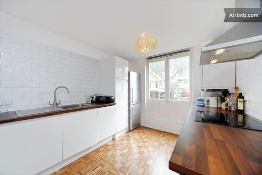 New open-plan kitchen: fitted cupboards with dishwasher, full fridge/freezer, and state of art oven
