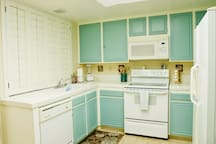 Bright well equipped kitchen with morning sun