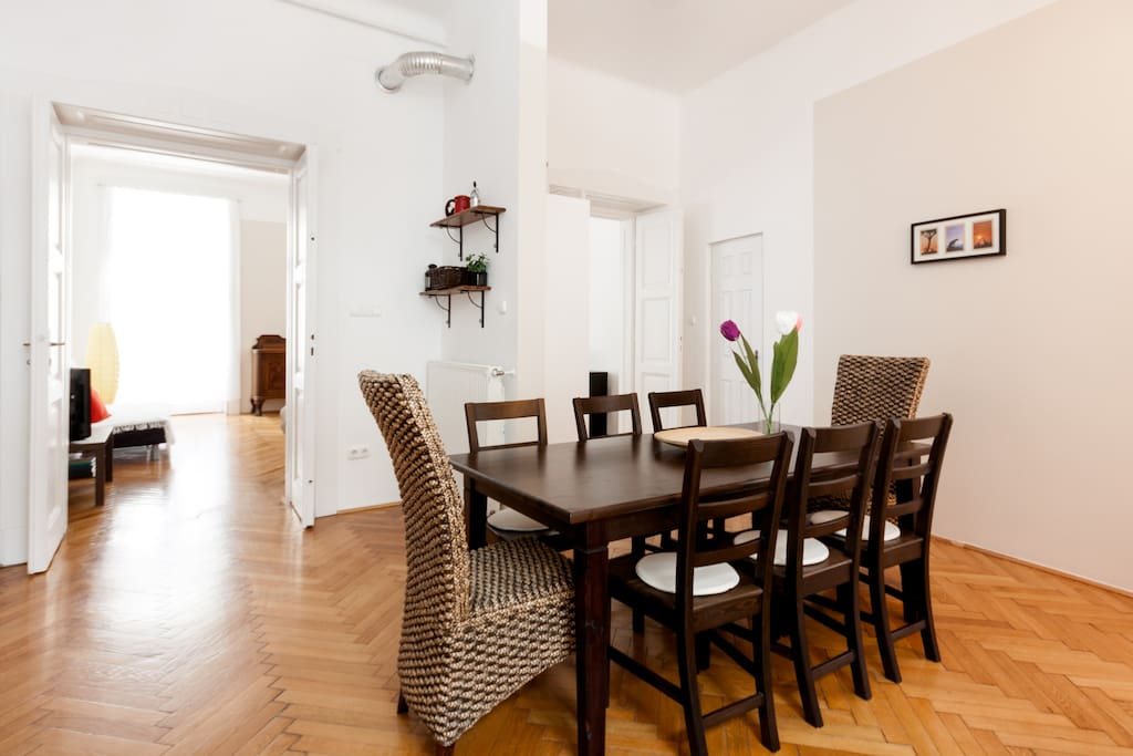Dining area with  doors opening to the living room