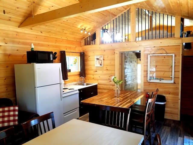 Fully equipped kitchen with bar and table; seats 9.