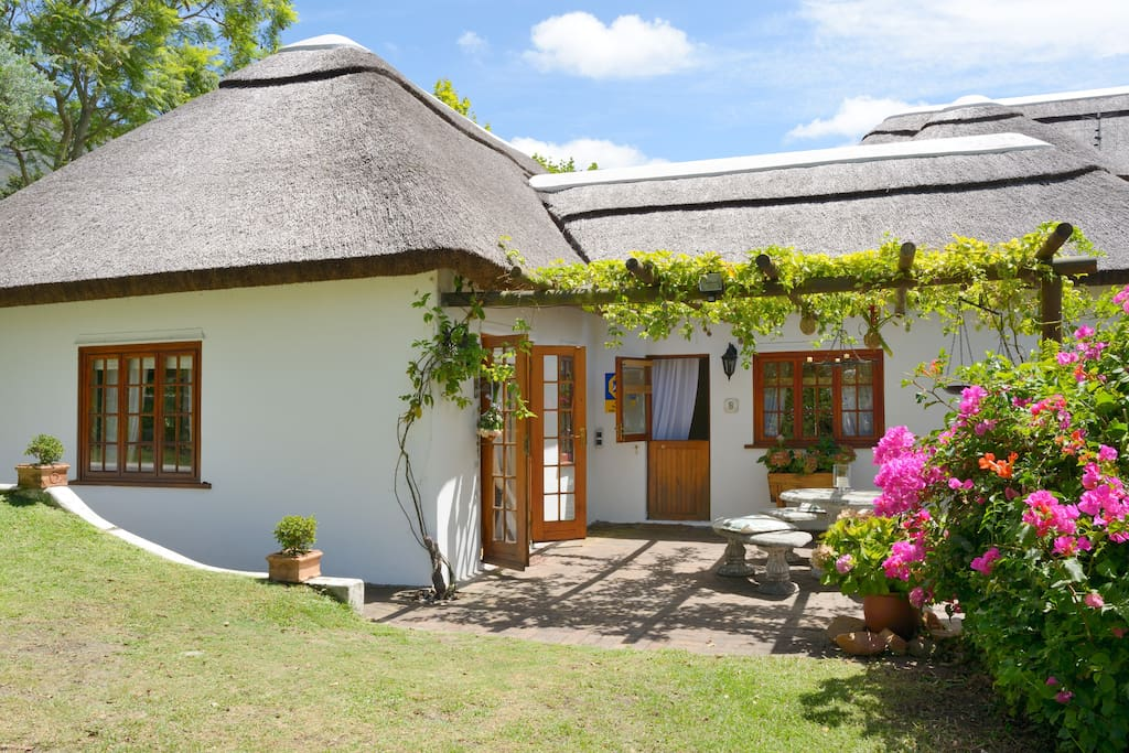 The cottage with separate entrance and private patio with bbq leading onto a large garden