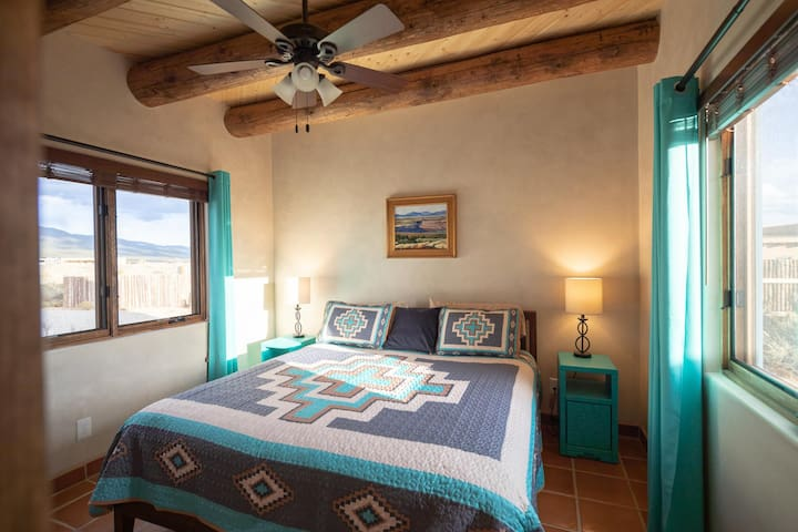 Bedroom with mountain views and King size bed. Ceiling fan for your comfort.