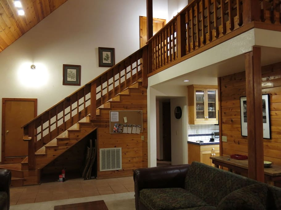 Stairs to master bedroom and loft from living room.