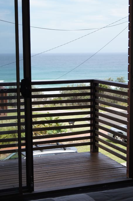 View from master bedroom over looking balcony and Rennies beach
