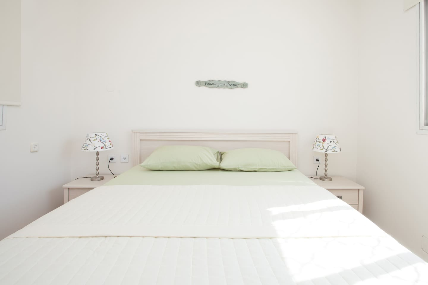 A comfortable queen size bed is waiting for you