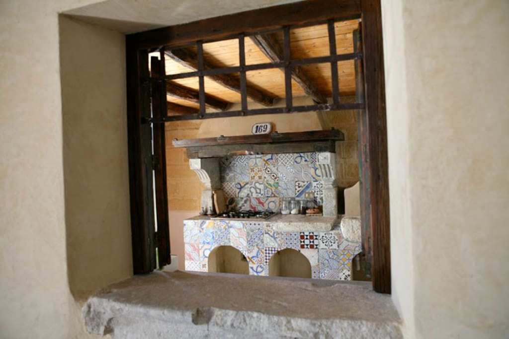 kitchen resembling the old times – all the walls have been covered with typical antique ceramic tiles
