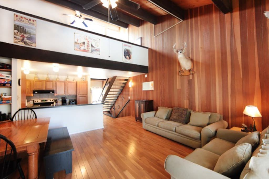 hardwood floors, comfy sofas may the great room a wonderful place to gather