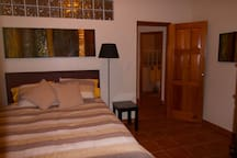 Terrace Bedroom has queen size bed, private terrace, handcrafted wood closet and dresser, TV with DVD player
