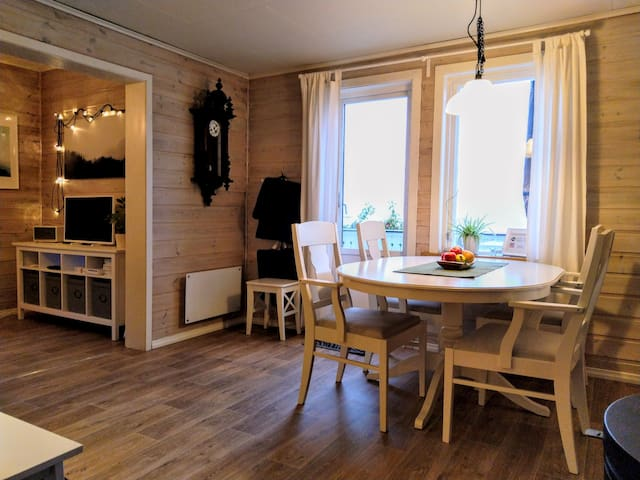 Dining-area with access to the front terrace and nice view over the fjord. Dining-table sits 6 guests.