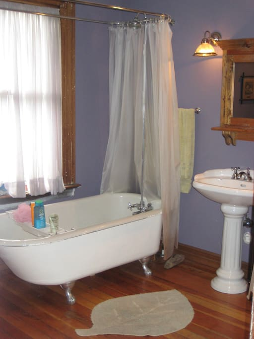 Clawfoot tub, bidet, piped in music and a comfy chair
