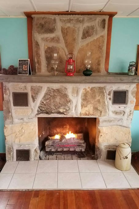 Gas fireplace. Working vintage oil lamps.