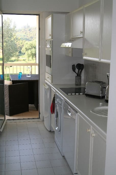 Sleek, full equipped kitchen with direct access to balcony and those views again.