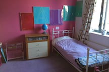 Children's bedroom with 1 single bed and 1 smaller bed