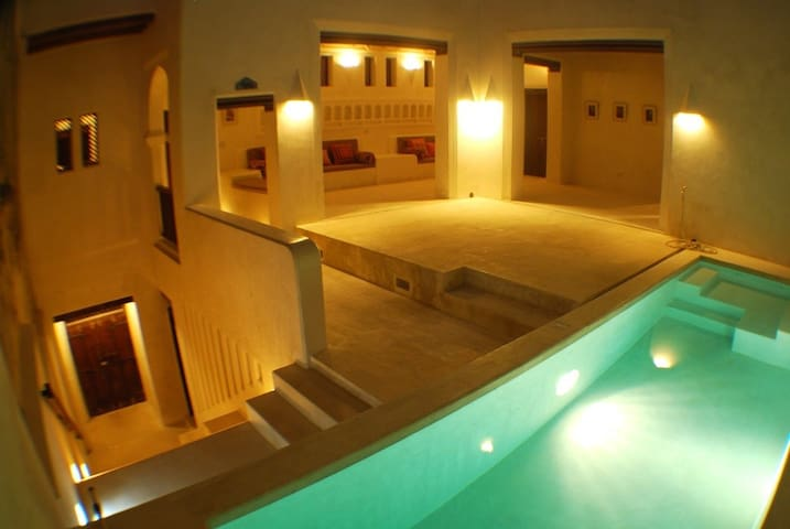 First-floor with pool at night