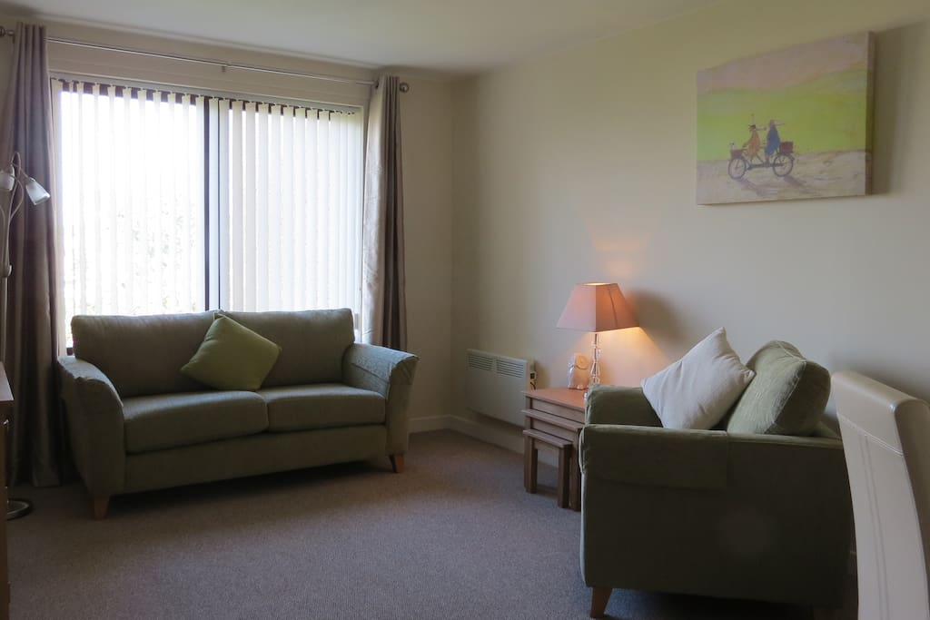 Modern, cosy lounge with great views of gardens and steeples