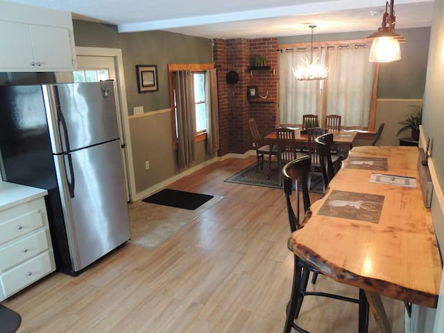 Bright, spacious kitchen with wheel chair accessible sink, breakfast bar and new stainless appliances.