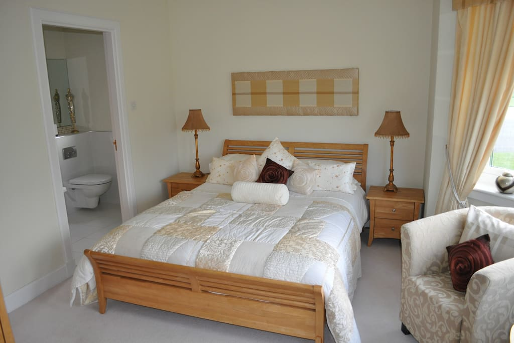 Large bedroom with king size bed and en-suite