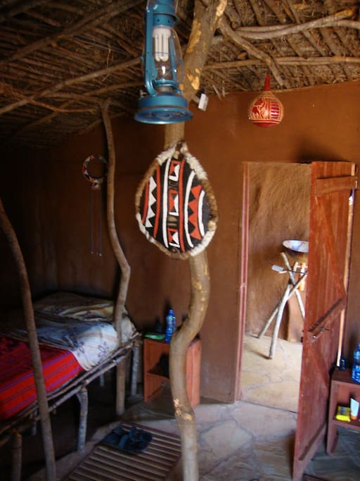 The interior of the hut is decorated with Maasai handicrafts.