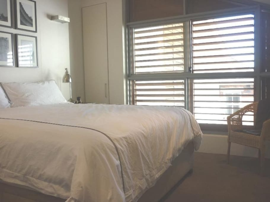 Upstairs Bedroom area with french shutters and king size bed