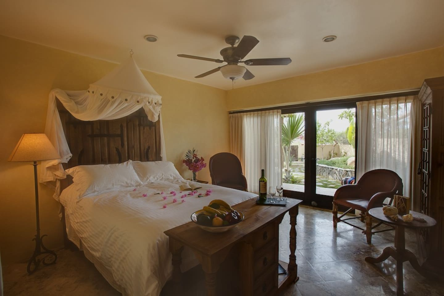 Spacious garden level guest room with Queen bed and in-room refrig & morning coffee.