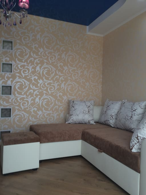 Decorated 3-D wallpapers with a sofa.