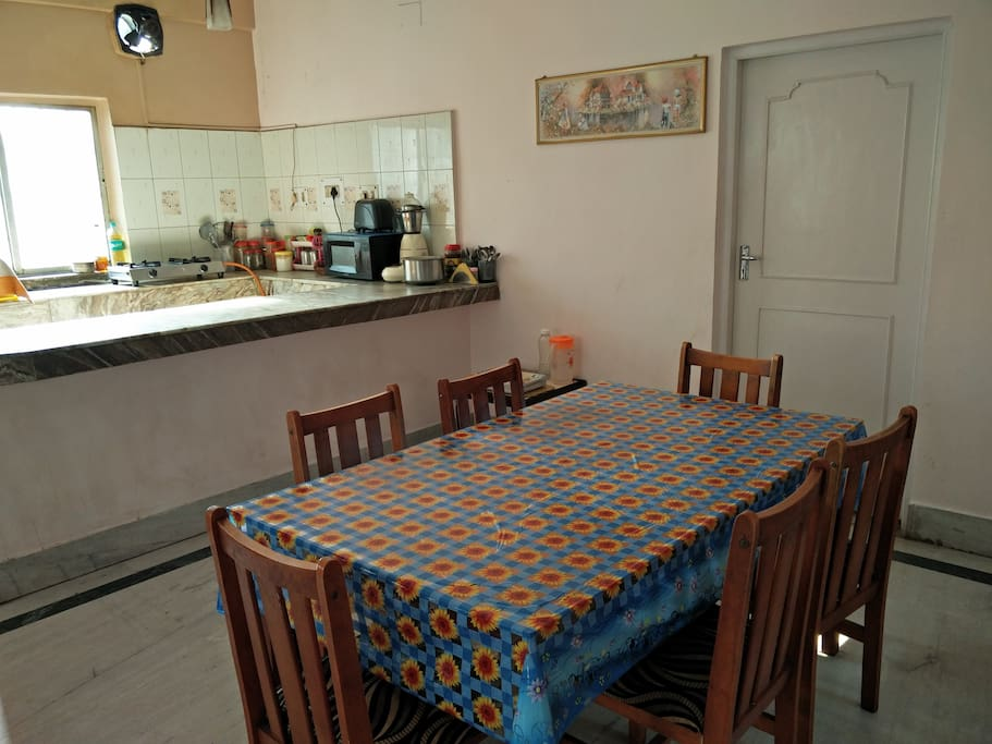 Dining table with an open kitchen with all cooking essentails. Breakfast to be provided.