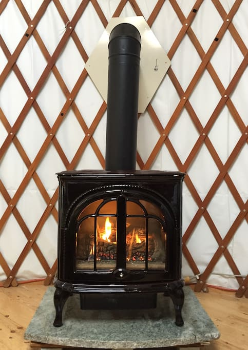 Cozy gas fireplace keeps the yurt toasty all winter
