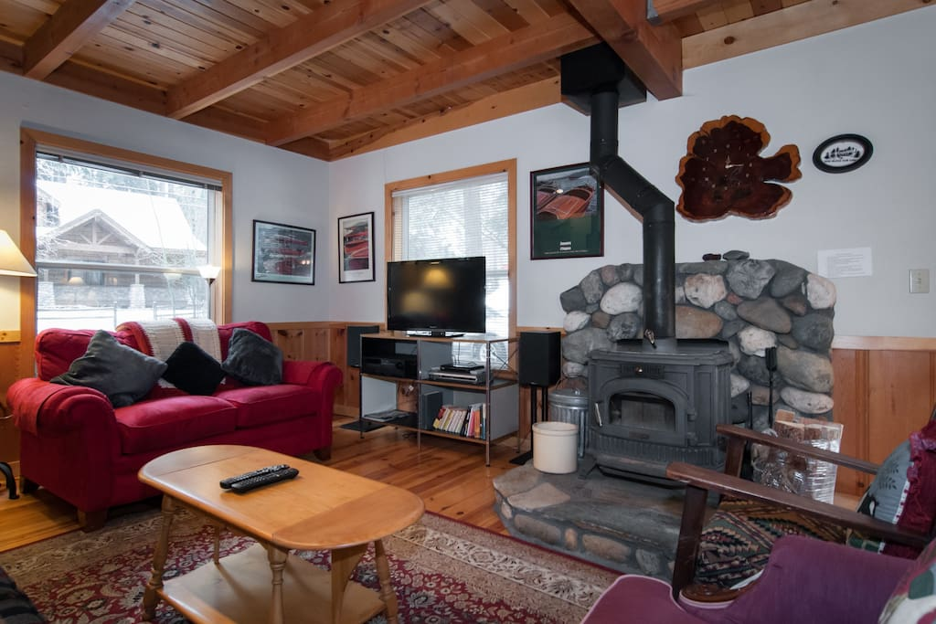 living room with wood stove to keep you toasty