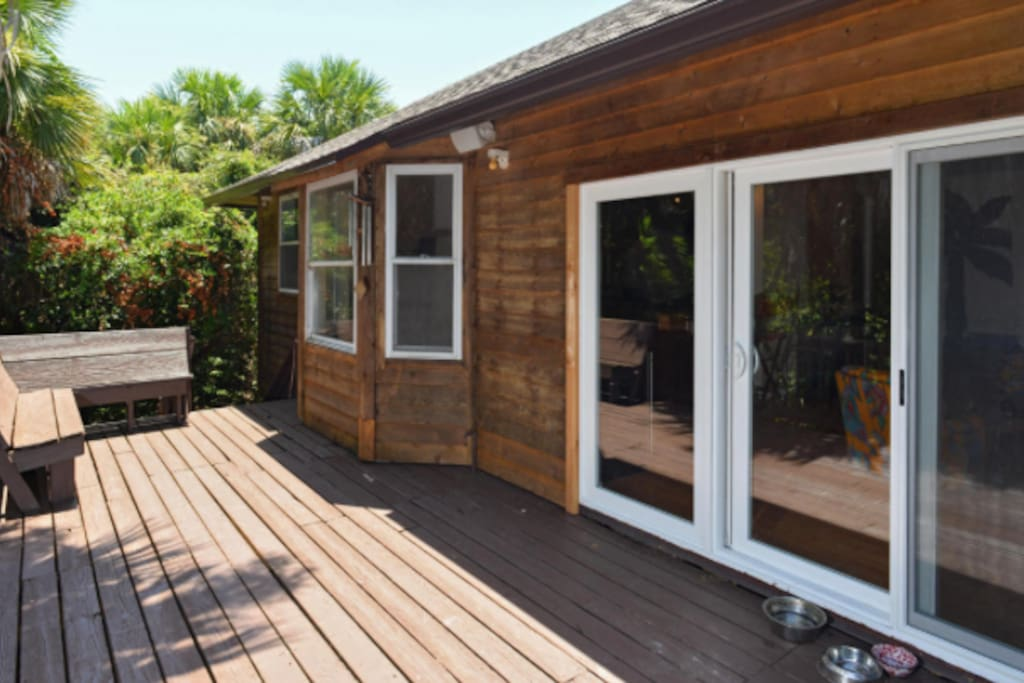 The back deck is fitted out with teak furniture for relaxing and dining.