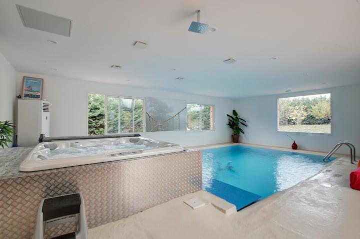 VillaChambres Jacuzzi piscine d'intérieur chauffée