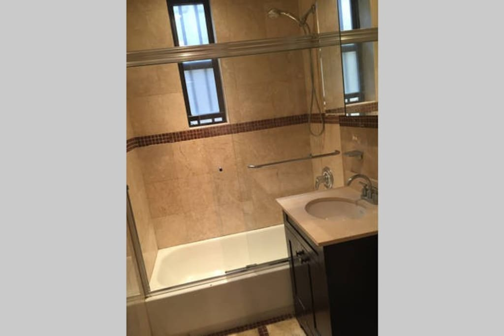 bathroom with shower (shower is shared with other guests)