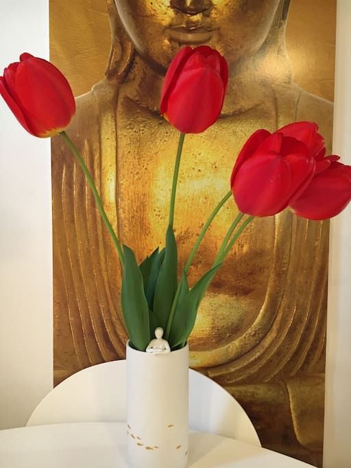Buddha with garden picked tulips!