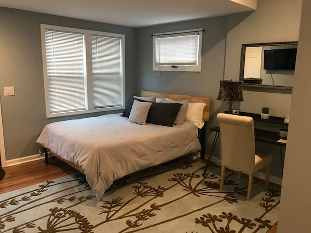 """This is what we consider to be the master bedroom. There is a small bathroom and laundry located inside this bedroom. There is a 40"""" TV and large closet as well."""