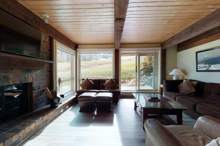 Ski-in/ski-out condo with shared pool and hot tub with slope views