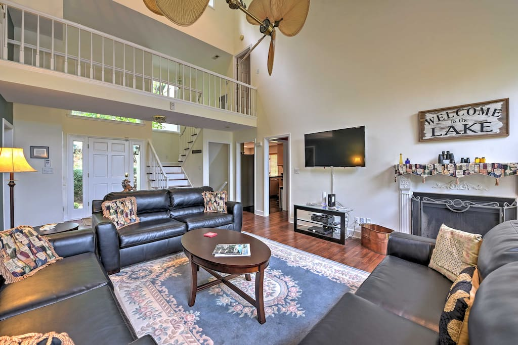 Step inside the home's gorgeous living room, with a high vaulted-ceiling.